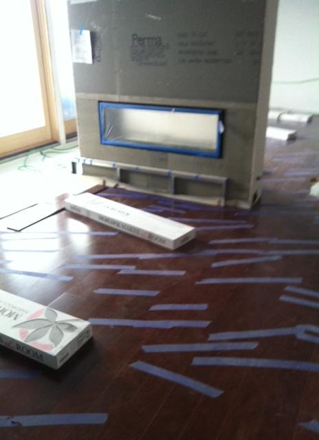Hardwood floor being installed!